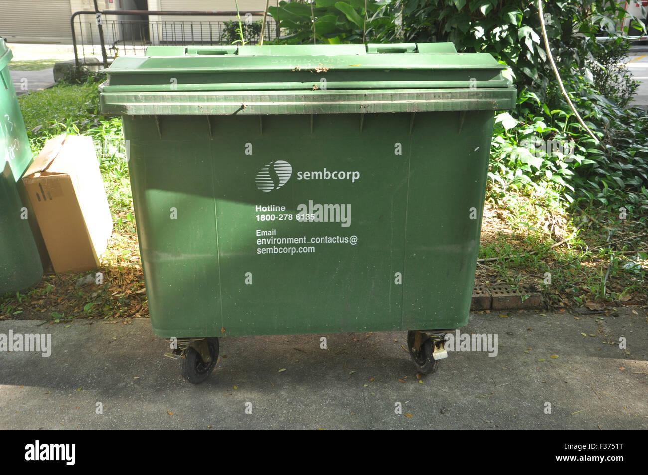 A garbage bin placed near Kallang Road, Singapore. - Stock Image
