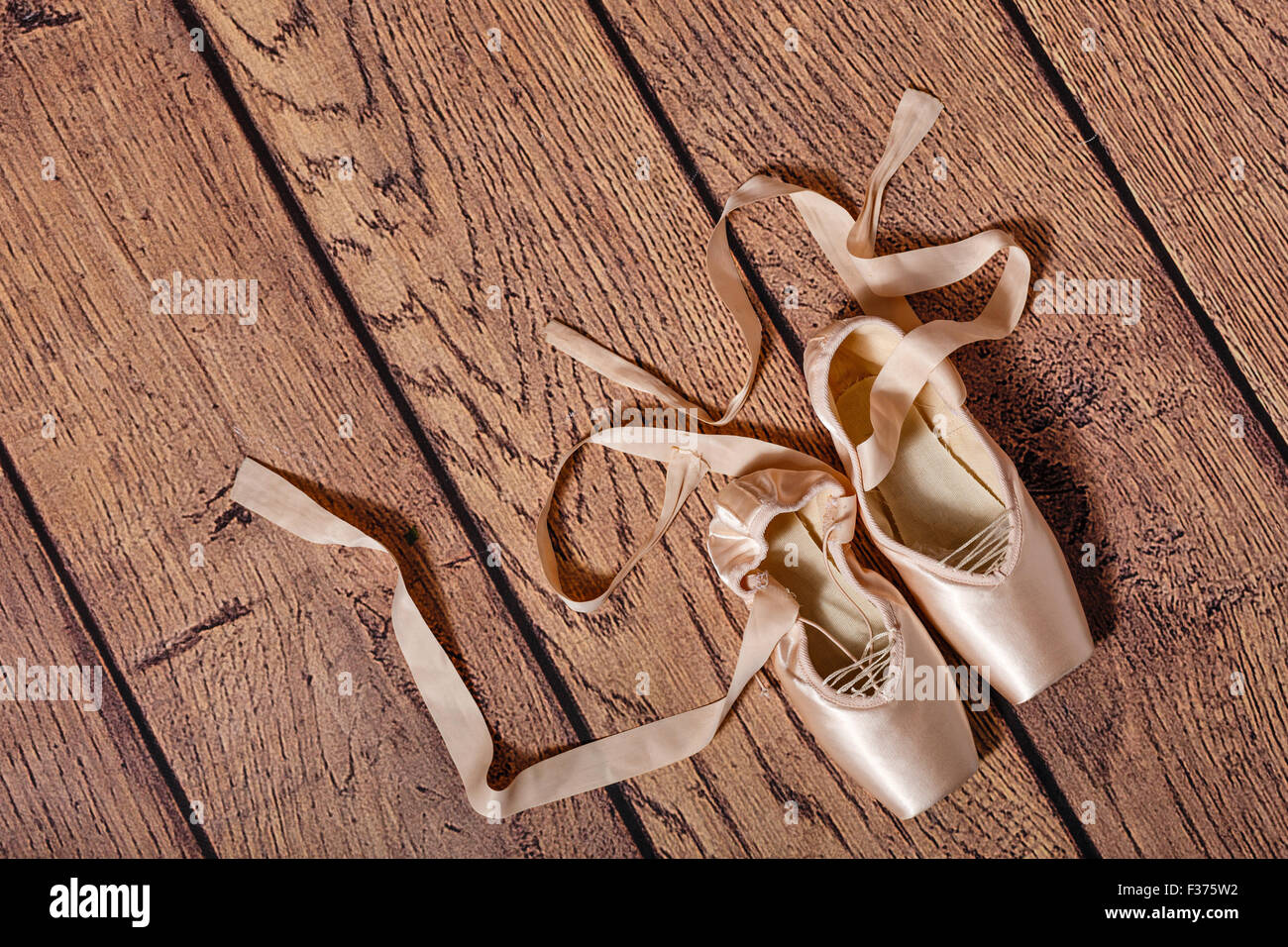 ballet pointe shoes lie on the wooden floor retro the concept of