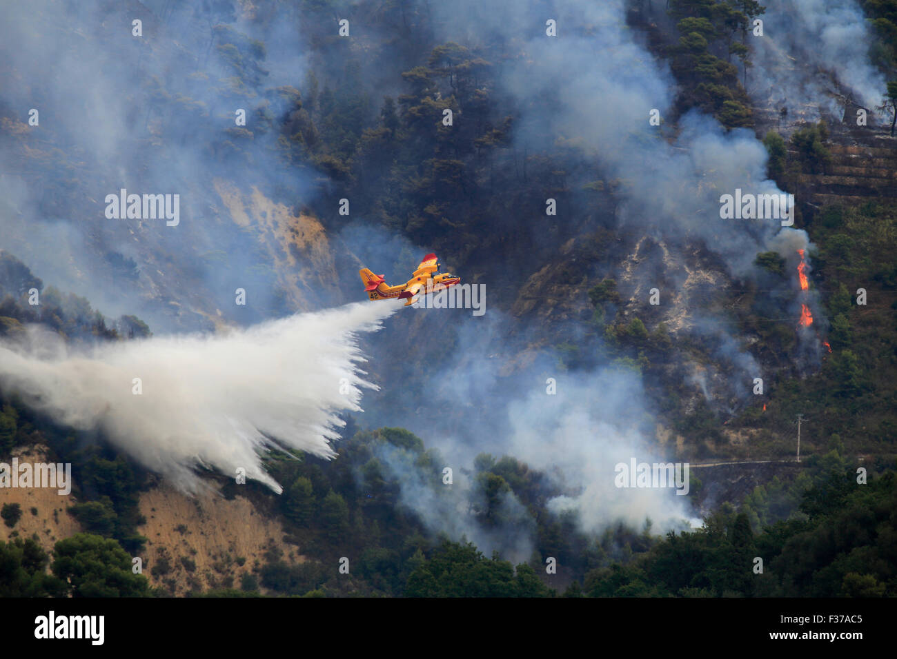 Fire extinction, firefighting aircraft Canadair CL 415, French Sécurité Civile, dropping seawater, large - Stock Image