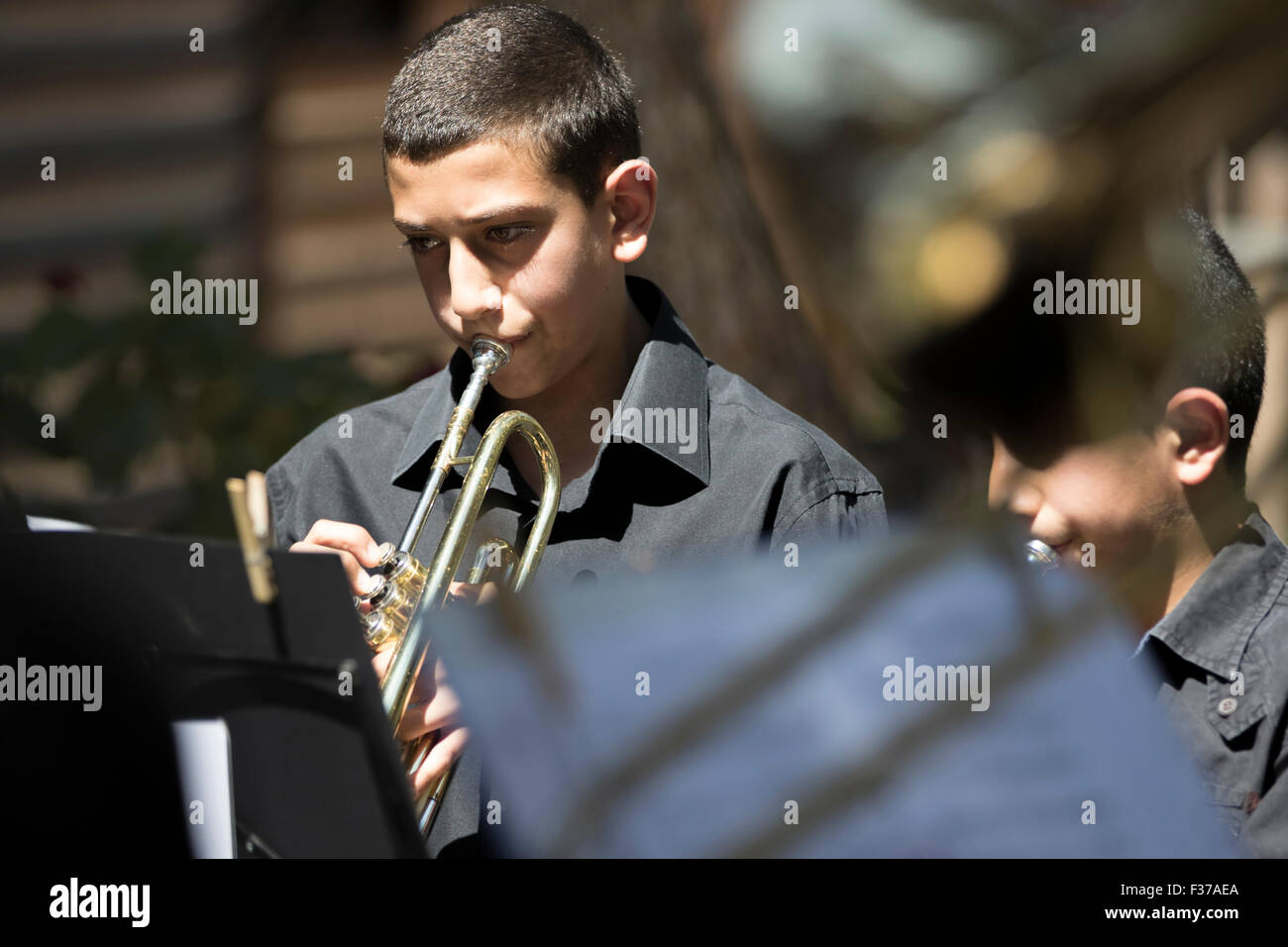 Members of Brass for Peace play in the grounds of Al-Quds University, Palestine to spread messages of peace - Stock Image