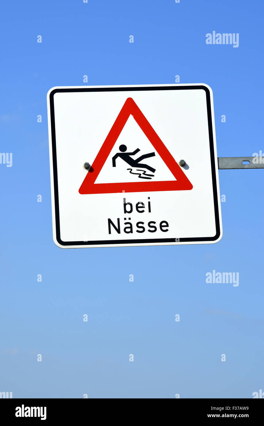 Warning sign, risk of slipping in wet conditions, in German, Germany - Stock Image