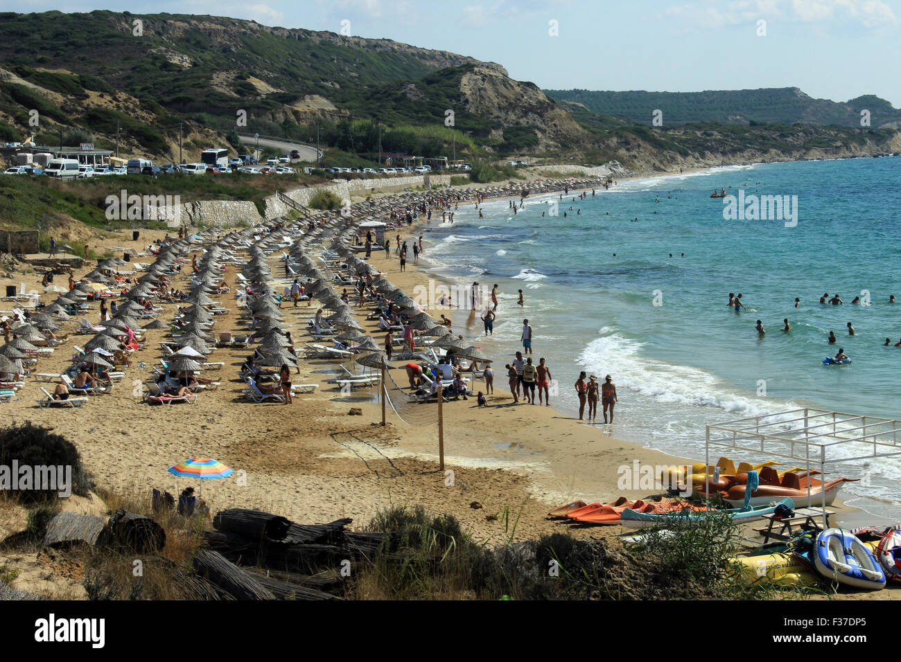 Izmir, Turkey - September 26, 2015: People are taking sun bath at the sandy coast of Bozcaada, Canakkale, Turkey Stock Photo