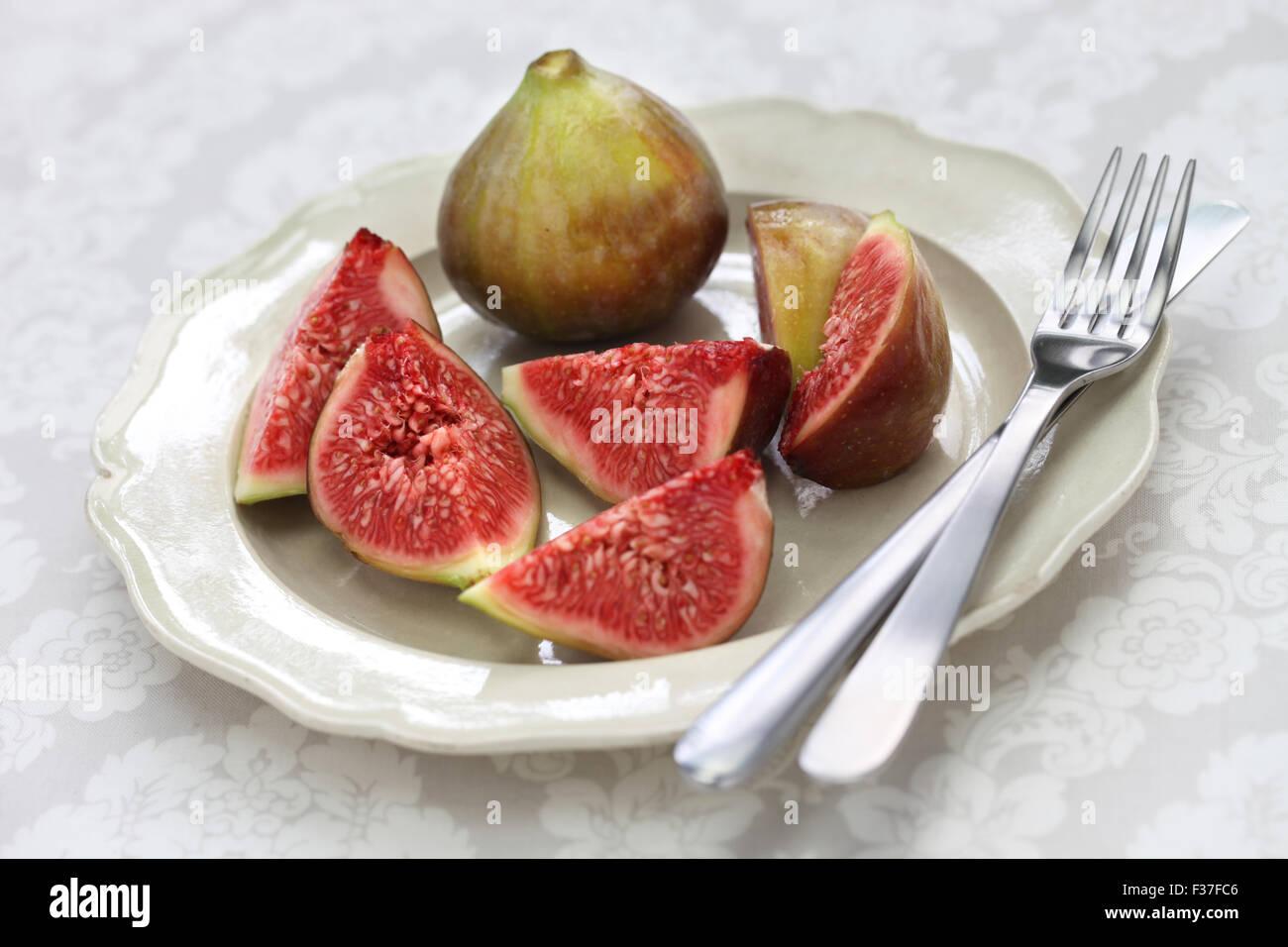 fresh figs cut open, autumn dessert Stock Photo