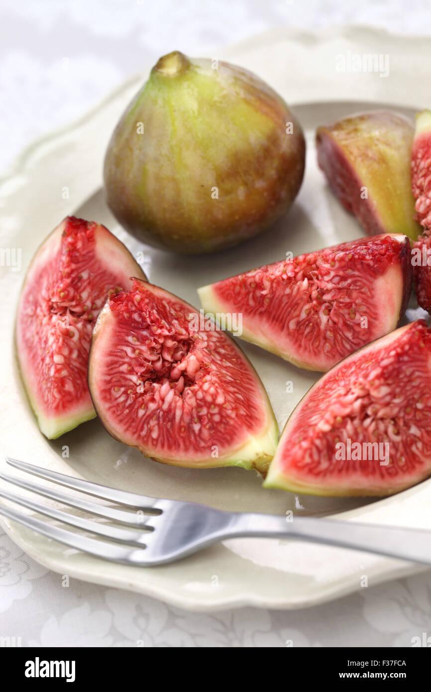 fresh figs cut open, autumn dessert - Stock Image