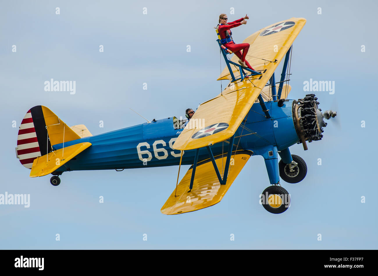 Emma Stewart Rigby wing walking atop a Boeing Stearman biplane plane operated by Aerobatic Tactics at Damyns Hall, - Stock Image