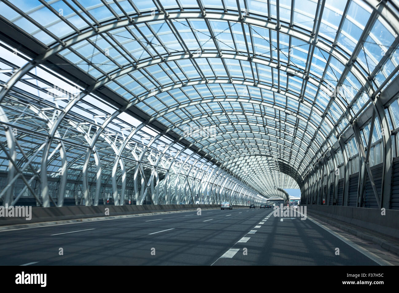 Road with sound barriers to reduce sound pollution in central Warsaw, Poland - Stock Image