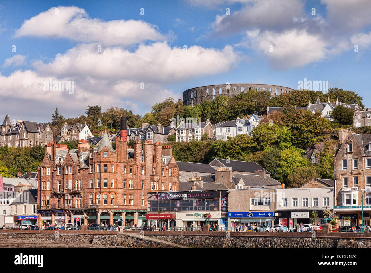 The promenade and McCaig's Tower at Oban, Argyll and Bute, Scotland, UK, - Stock Image
