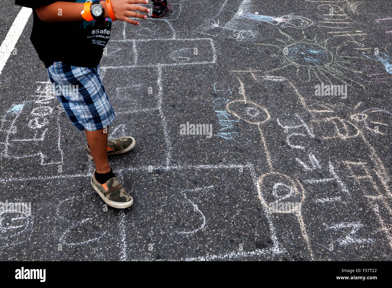 Child chalk drawing on pavement - USA Stock Photo