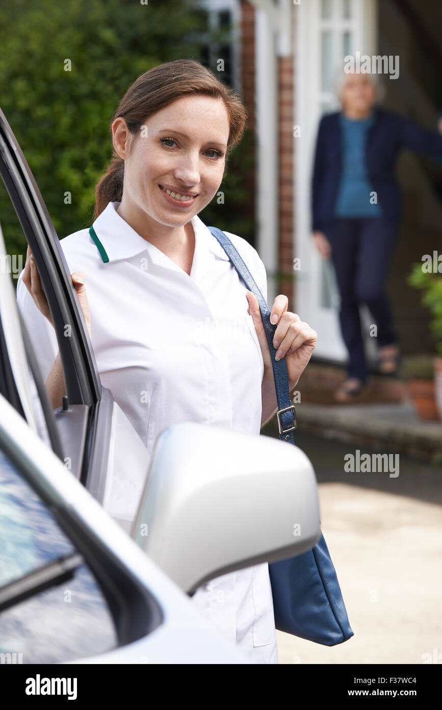Female Care Worker Visiting Senior Woman At Home - Stock Image