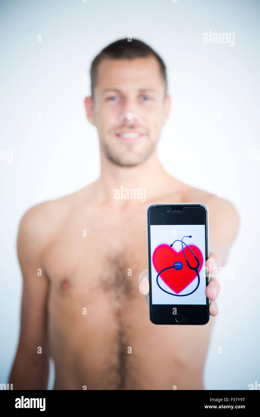 Man using health application on his Iphone. - Stock Image