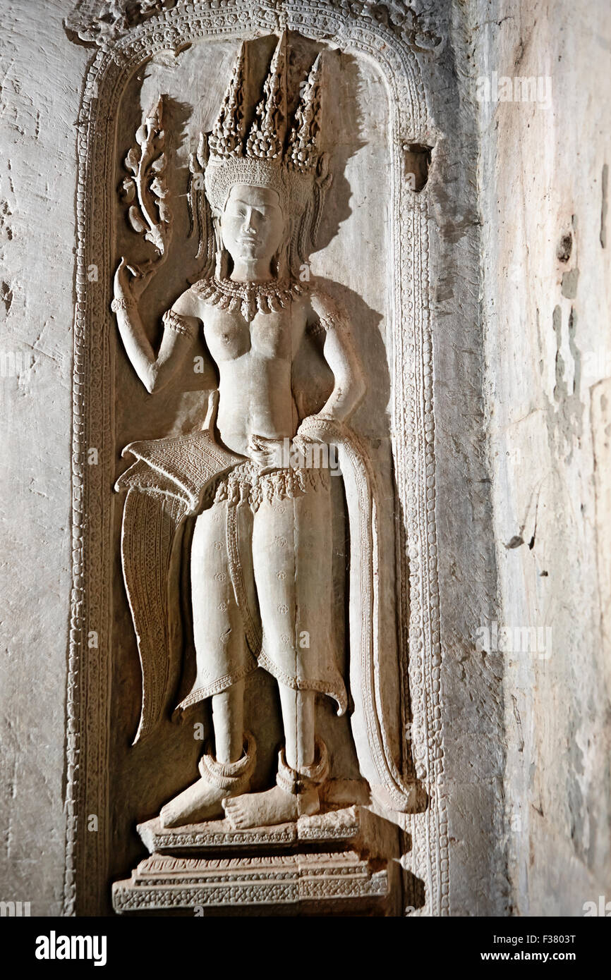 Bas-relief of apsara (celestial dancer) at Angkor Wat temple complex. Angkor Archaeological Park, Siem Reap Province, - Stock Image