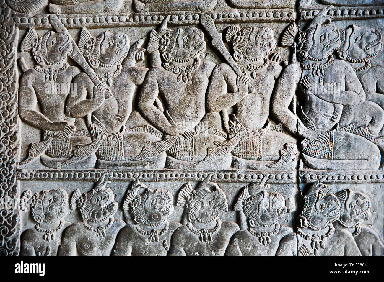 Fragment of bas-relief at Angkor Wat temple complex. Angkor Archaeological Park, Siem Reap Province, Cambodia. - Stock Image