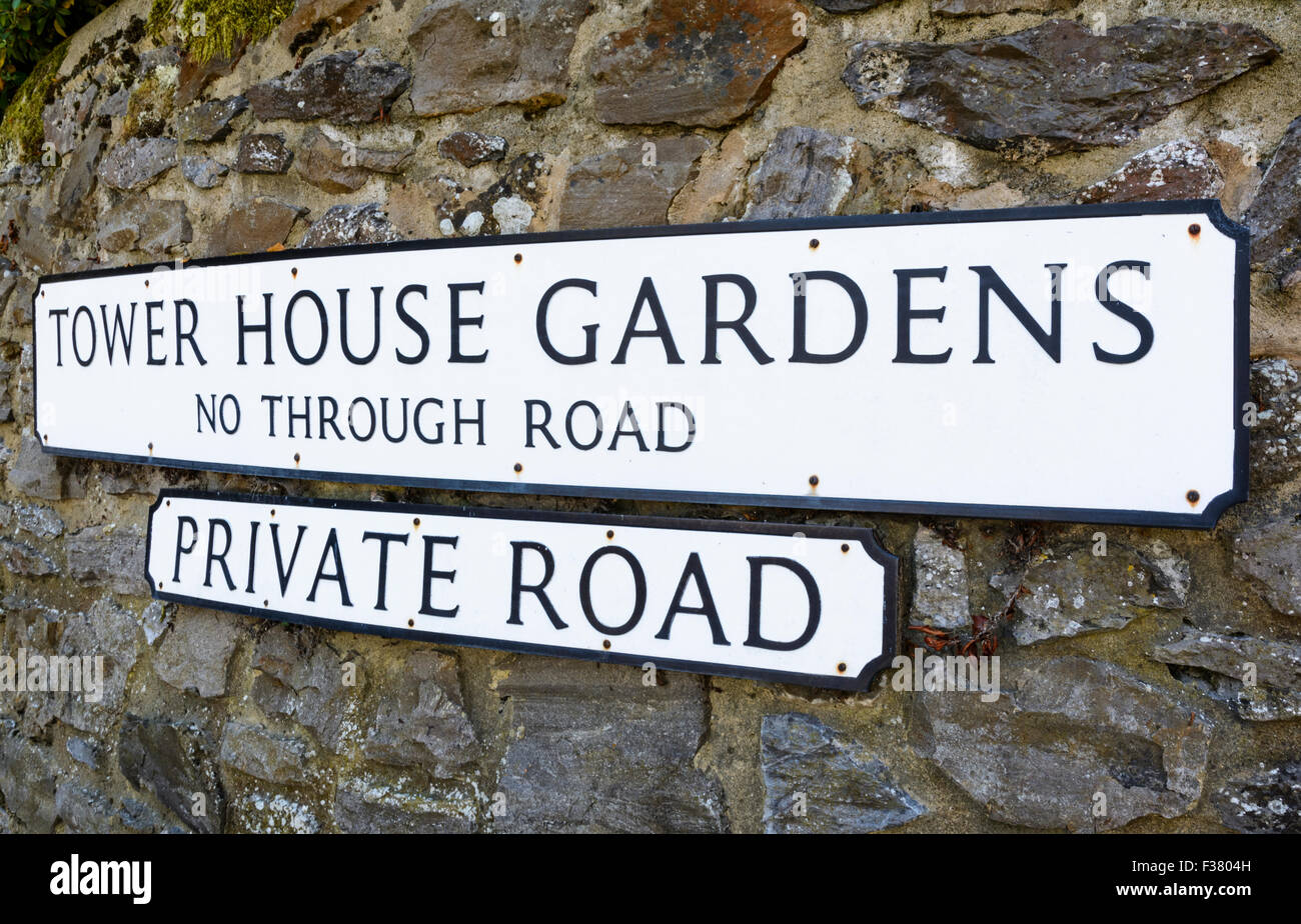 Private road sign on an old stone wall in Southern England, UK. - Stock Image