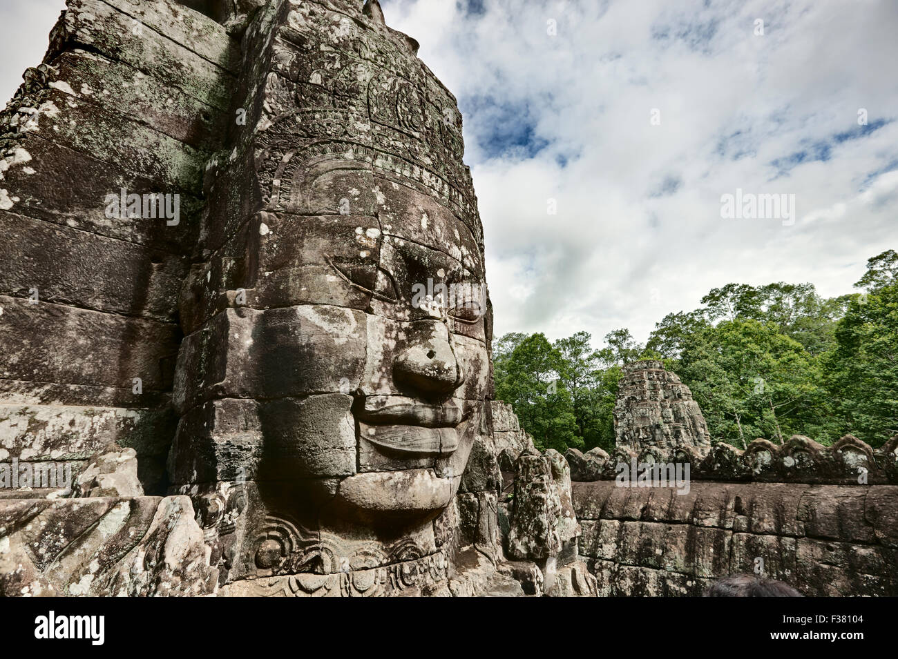 Carved stone giant face at Bayon temple in Angkor Thom. Angkor Archaeological Park, Siem Reap Province, Cambodia. Stock Photo