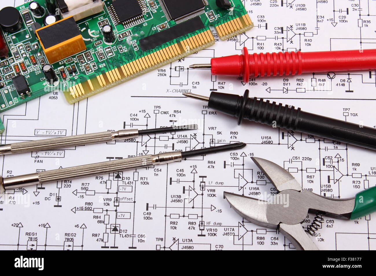 Circuit Diagram Stock Photos Images Page 2 Glass On The Electronic Schematic Diagramideal Technology Background Printed Board With Electrical Components Precision Tools And Cable Of Multimeter Construction Drawing