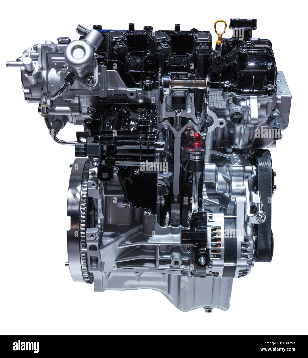 Cross section of a modern three cylinder car engine isolated on white - Stock Image