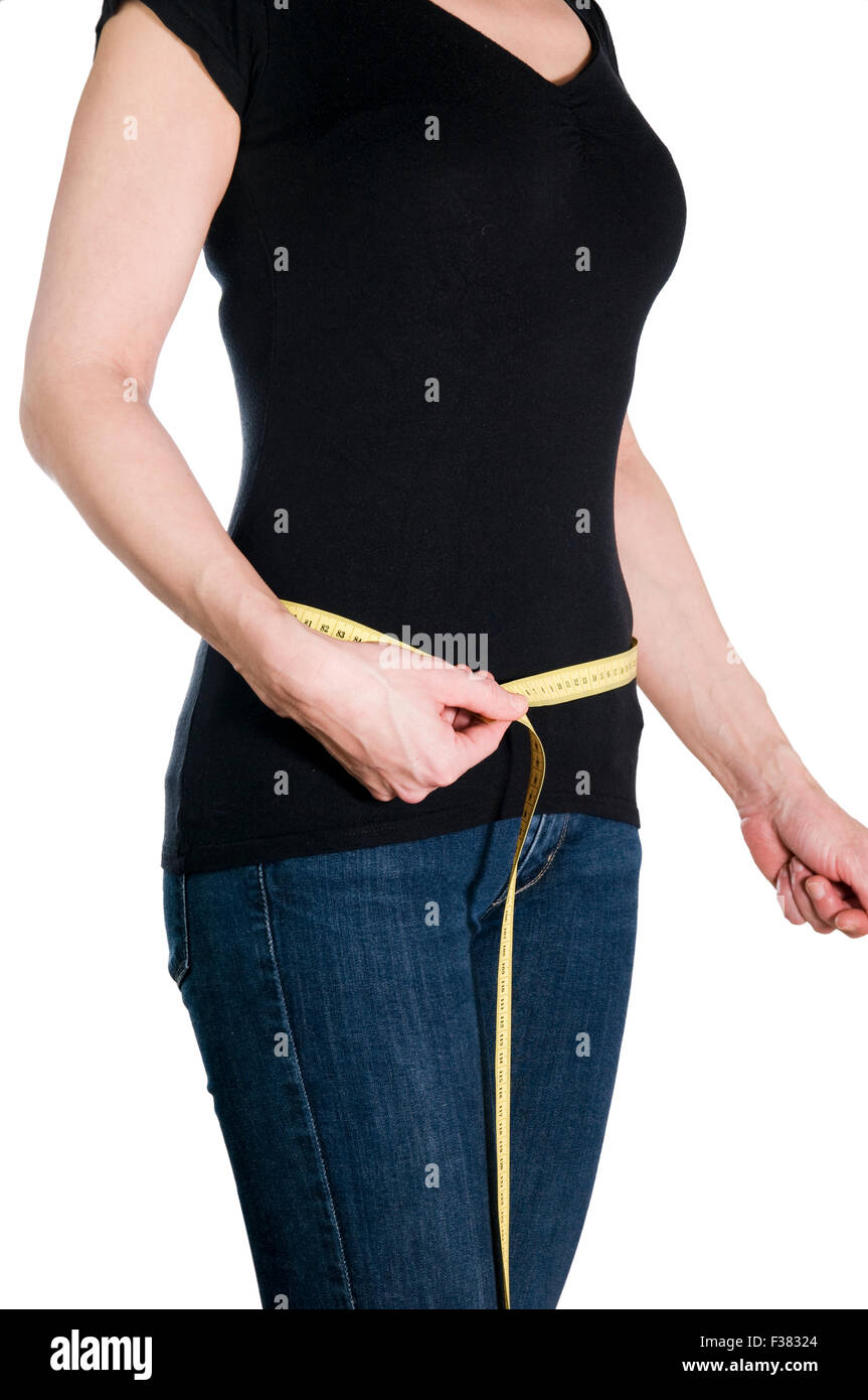 Three-quarters shot without head of a young woman standing at the hip held right-handed set yellow tape measure - Stock Image