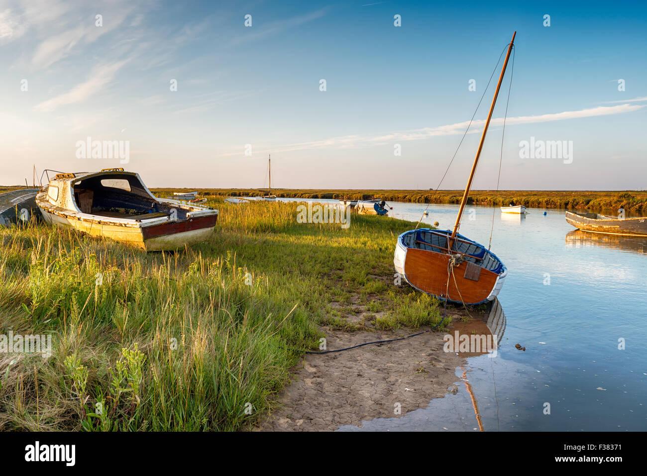 Fishing boats on the salt marshes at Blakeney on the Norfolk coast - Stock Image