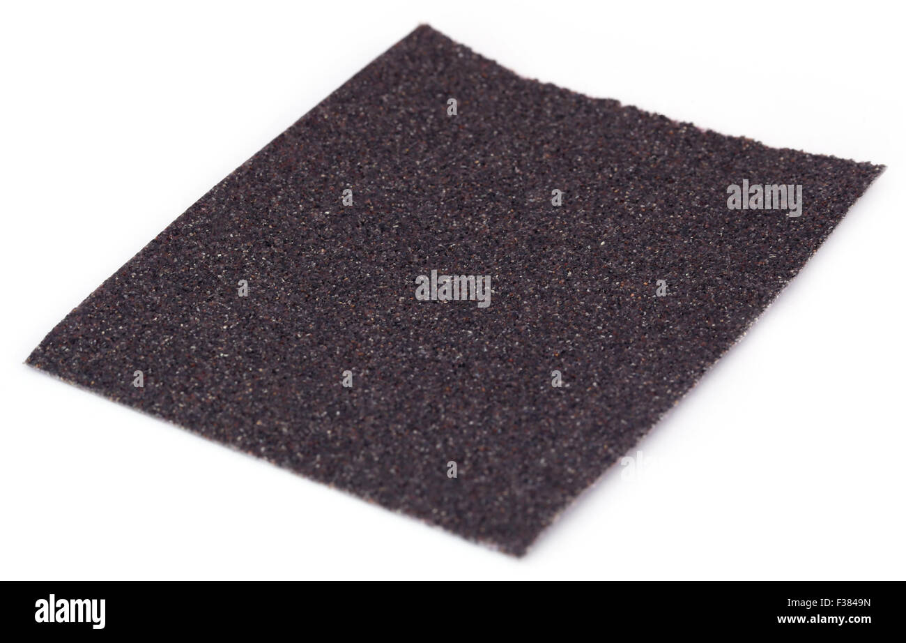 Sand paper sheet over white background - Stock Image