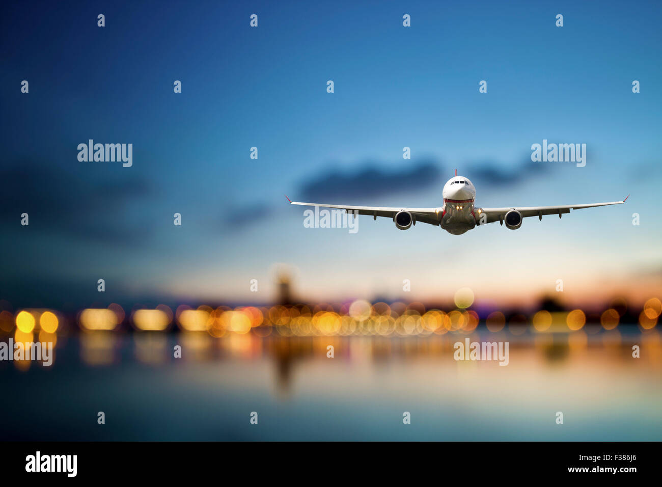 perspective view of jet airliner in flight with bokeh background - Stock Image