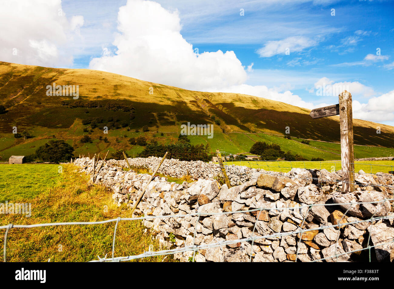Public bridleway to A683 sign post Cumbria UK England signs posts signpost - Stock Image