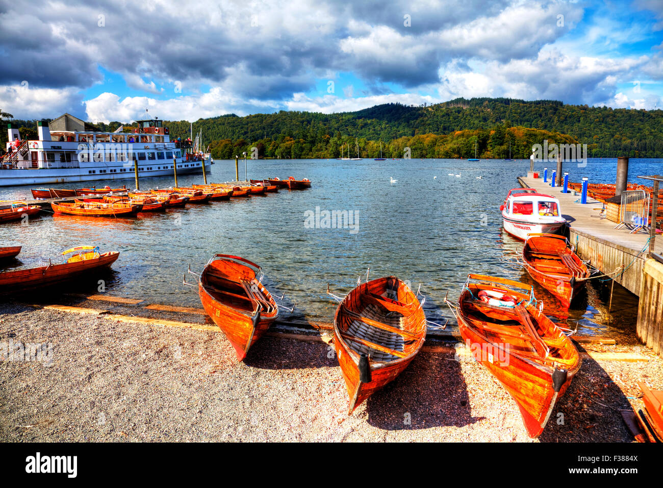Lake Windermere rowing boats tourist trips Cumbria UK England traditional wooden boat trip - Stock Image