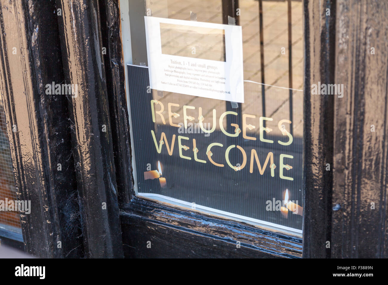 Refugees welcome sign refugee crisis help in shop window Kendal Cumbria UK England - Stock Image