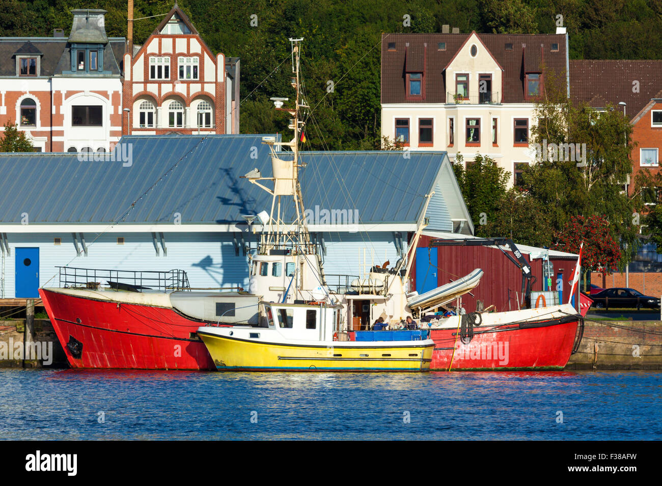 Two colorful fisher boats at Flensburg Osthafen - Stock Image