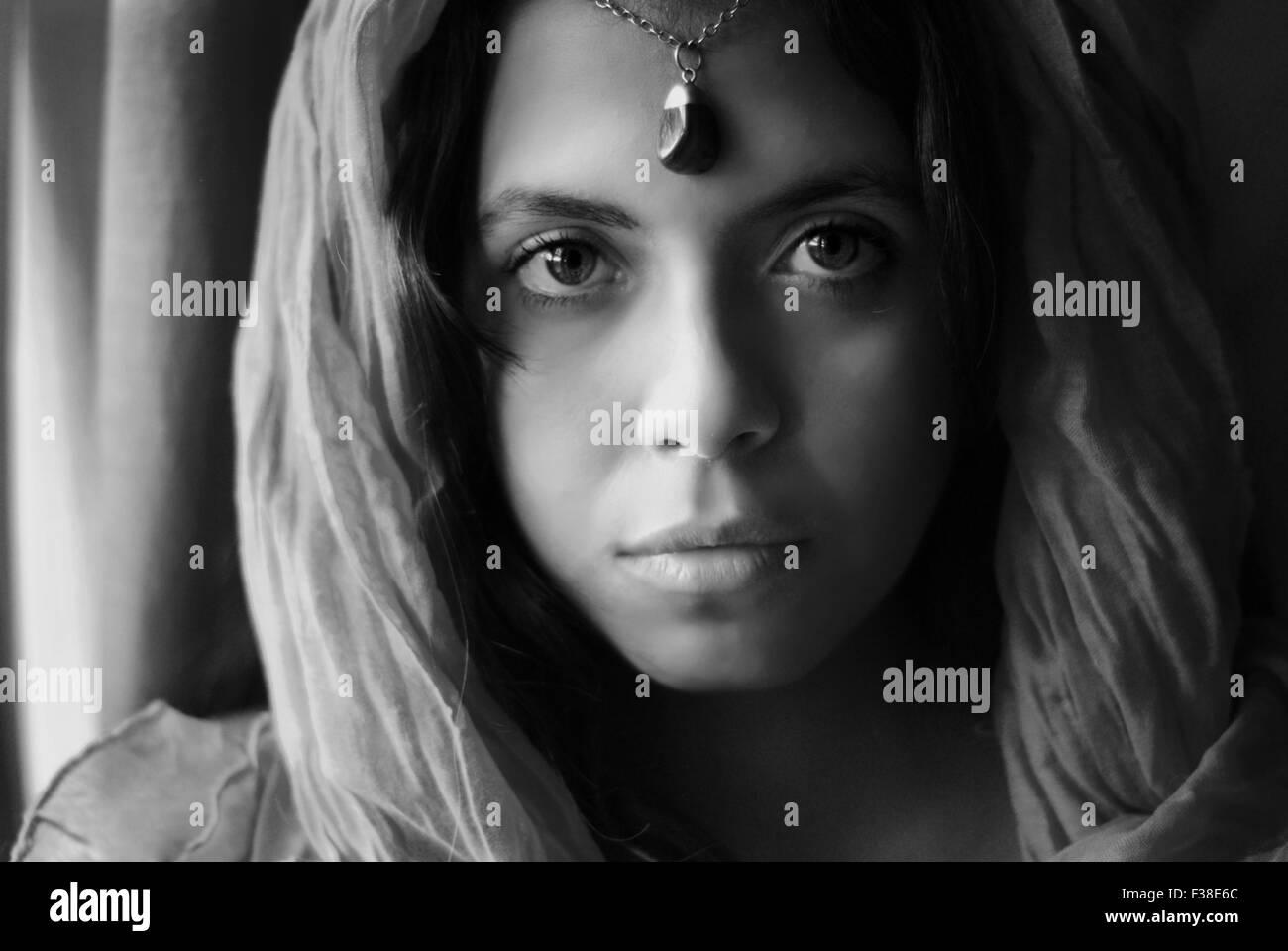 pure soul in black and white girl Arabian look like strange beauty - Stock Image