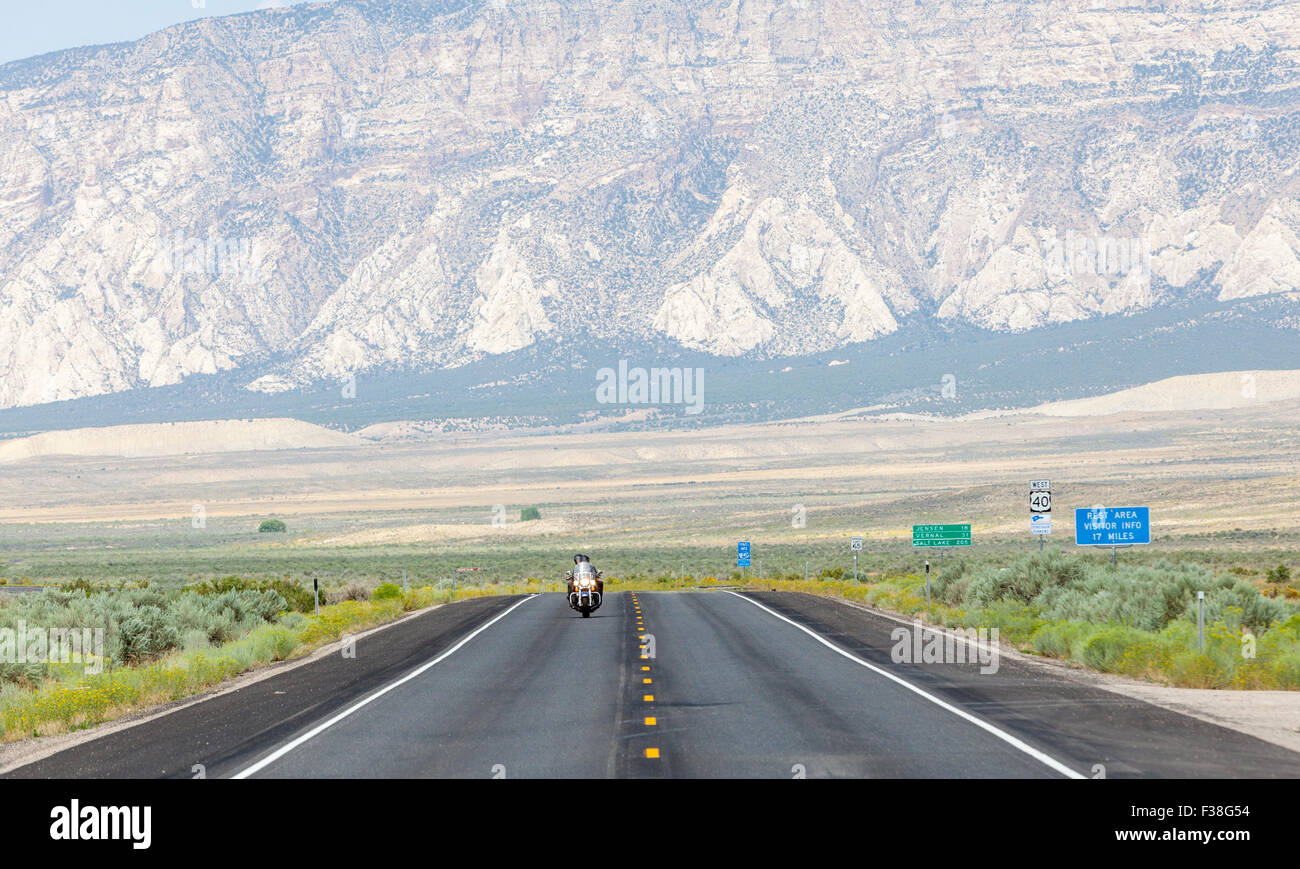 A couple on a motorcycle and speeding on a highway in Utah, - Stock Image
