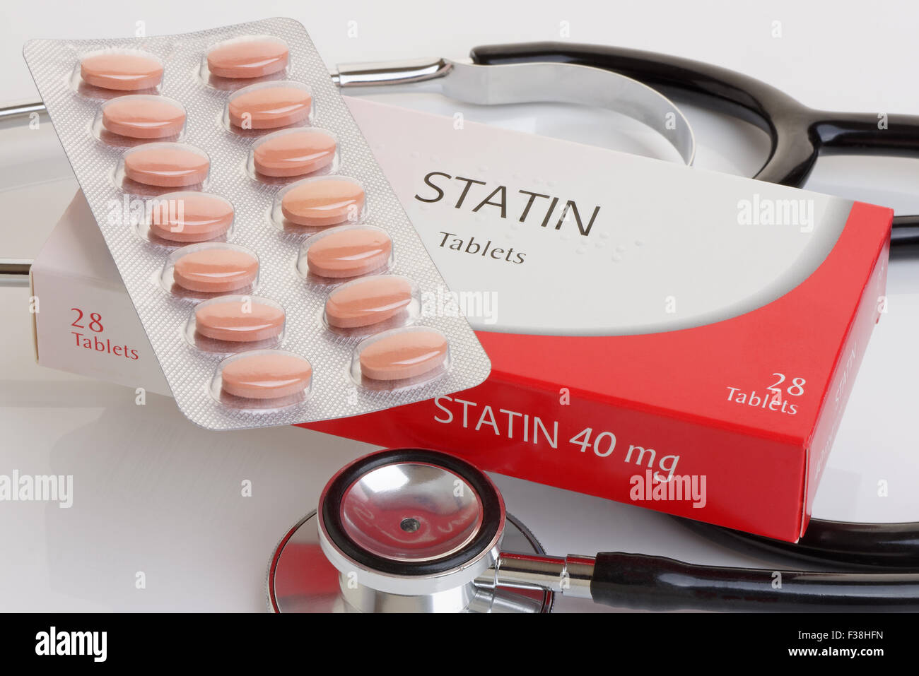 A generic pack of statins with a stethoscope.  A controversial anti cholesterol medication.All logos removed. - Stock Image