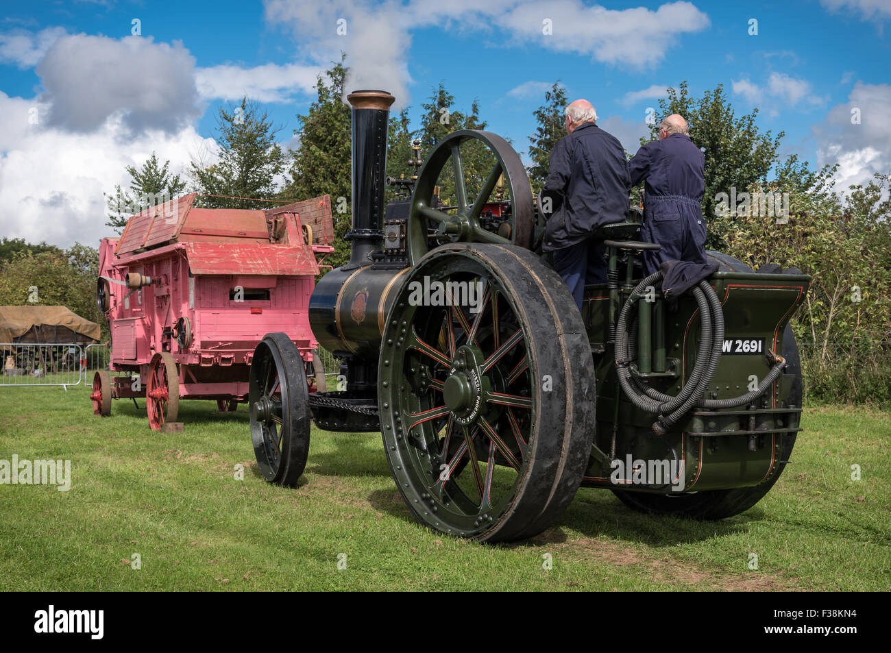 Vintage Steam Traction Locomotive with a vintage threshing machine - Stock Image