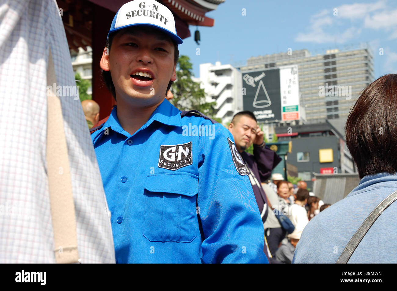 Security guard at the Sensoji Temple during the Sanja Matsuri Festival in Tokyo, Japan. - Stock Image