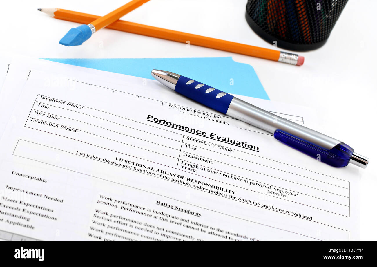 Blank performance evaluation with pen.  Selective focus on heading. - Stock Image
