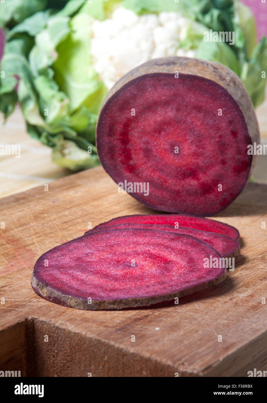 Vegan Salami, joking slices of red beet Stock Photo