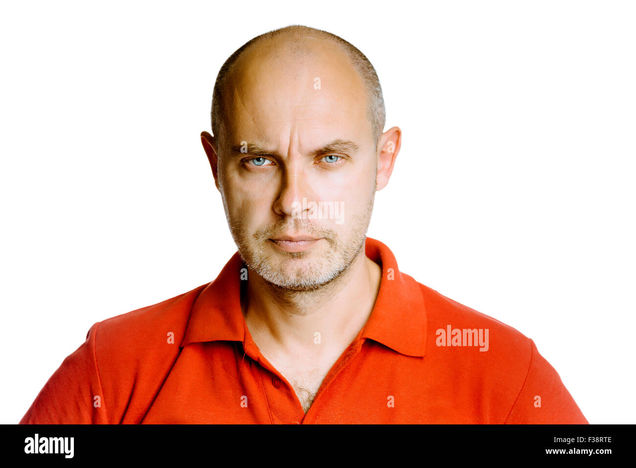 Unshaven fearsome blue eyes middle-aged man in a red T-shirt. Studio. isolated - Stock Image