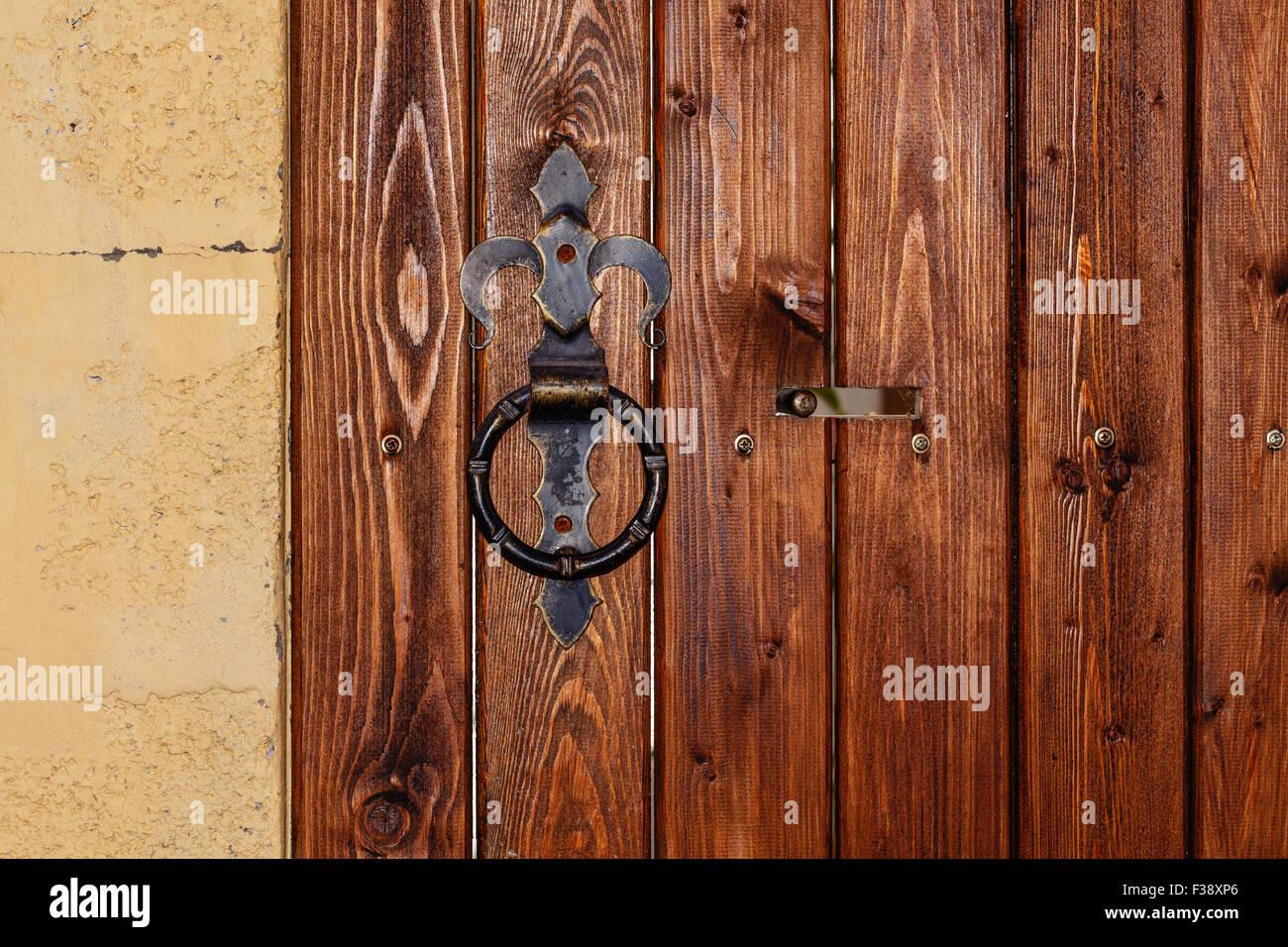 Round Metal Door Handle On A Wooden Door With Bolt. Safety Concept.