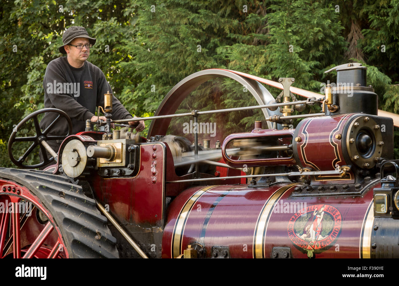 Detail of Vintage Steam Traction Locomotive showing movement of piston & Flywheel - Stock Image