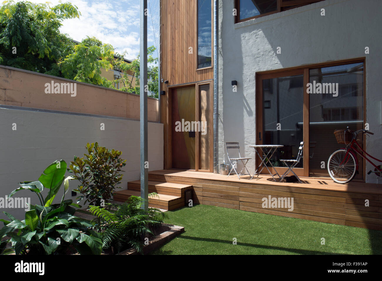 Entry courtyard with small terrace, garden and artificial