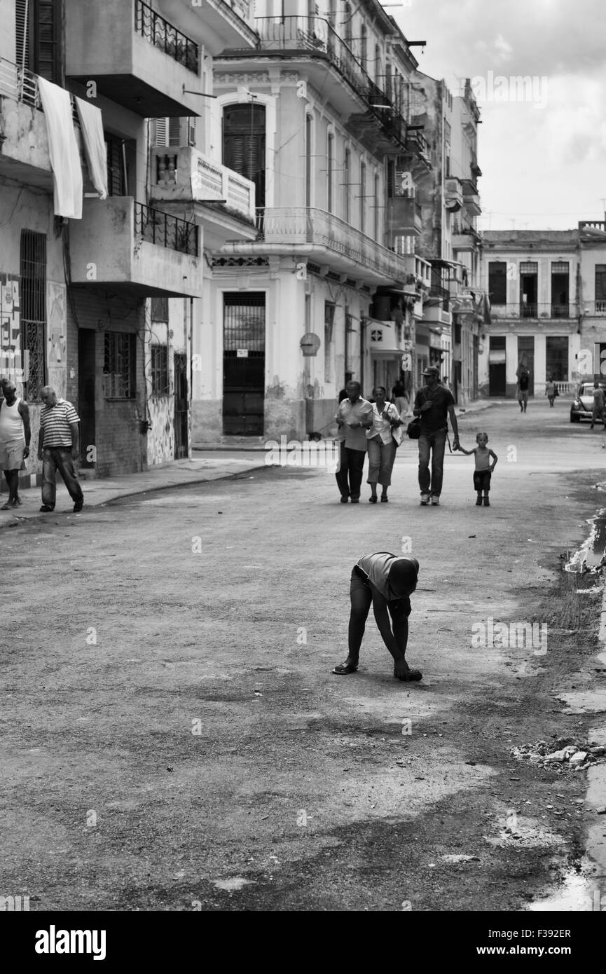 A typical central Havana street scene, children playing and a family walking. Cuba. - Stock Image