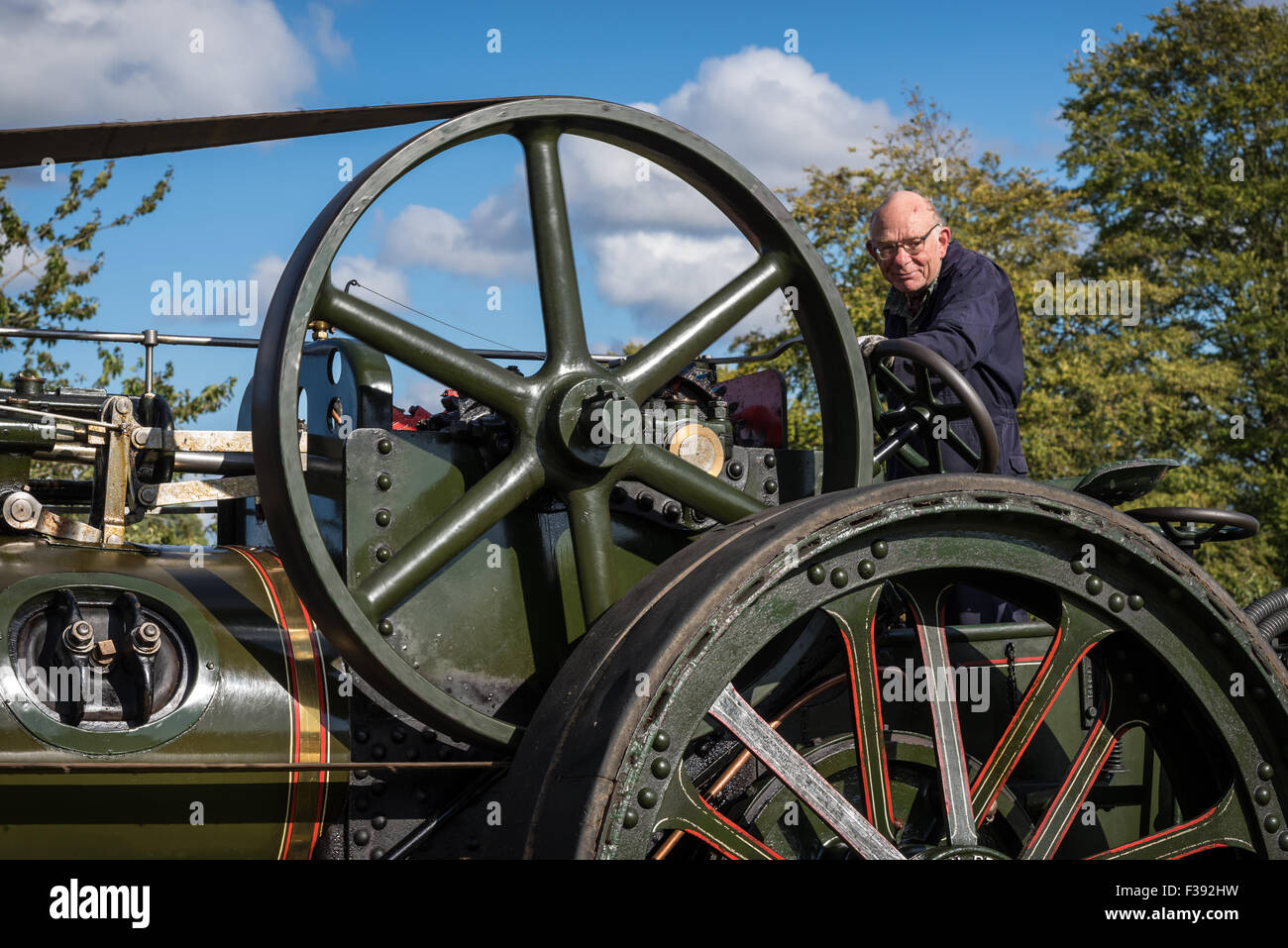Vintage Steam Traction Locomotive with flywheel driving a belt - Stock Image