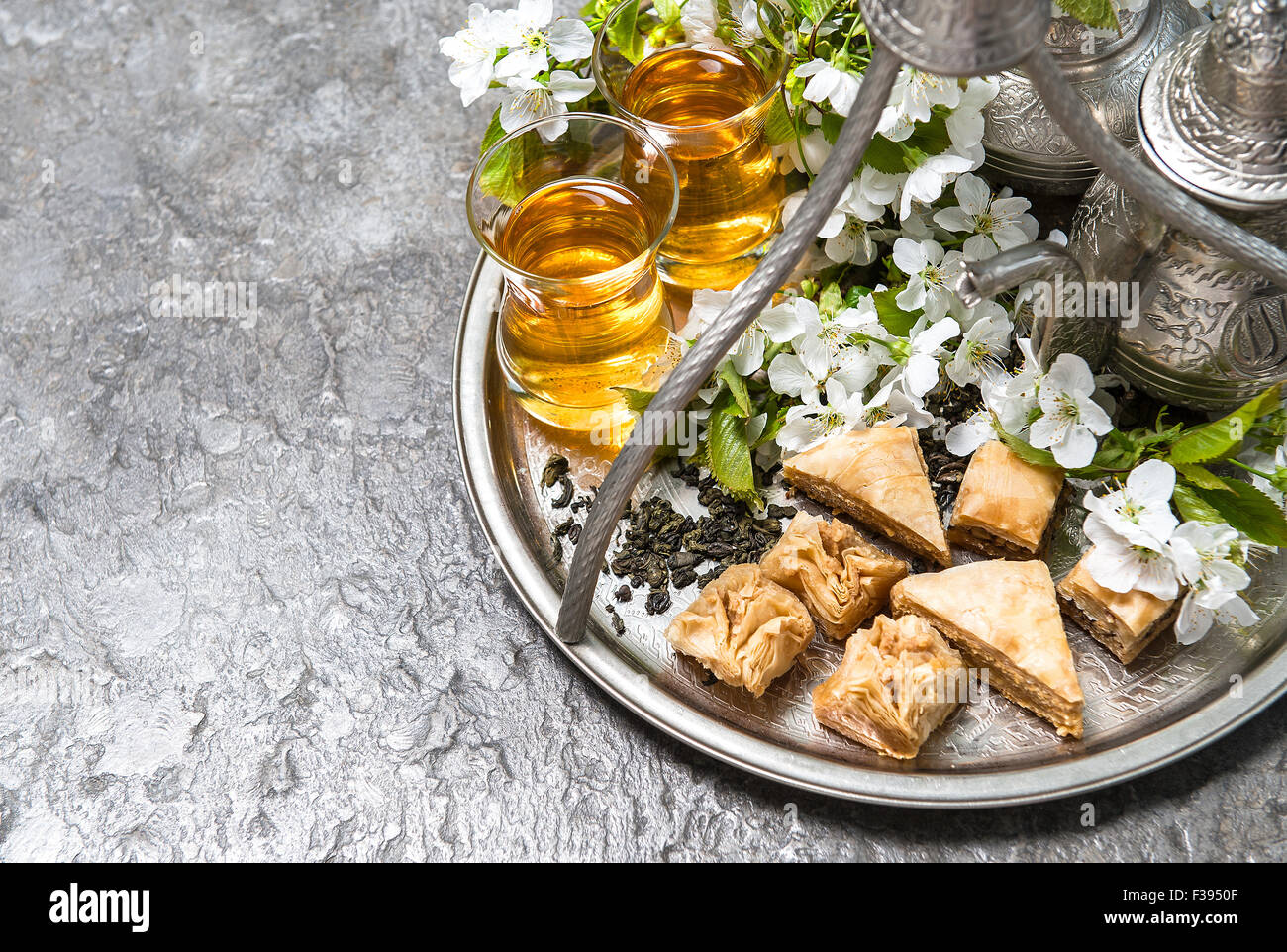 Wonderful Moroccan Table Eid Al-Fitr Decorations - tea-glasses-and-pot-traditional-sweets-islamic-holidays-decoration-F3950F  2018_42074 .jpg