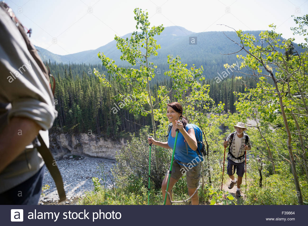 Hikers with poles on trail - Stock Image