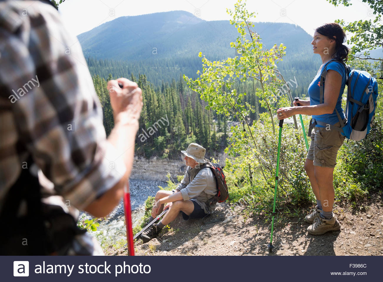 Hikers poles taking a break and looking view - Stock Image