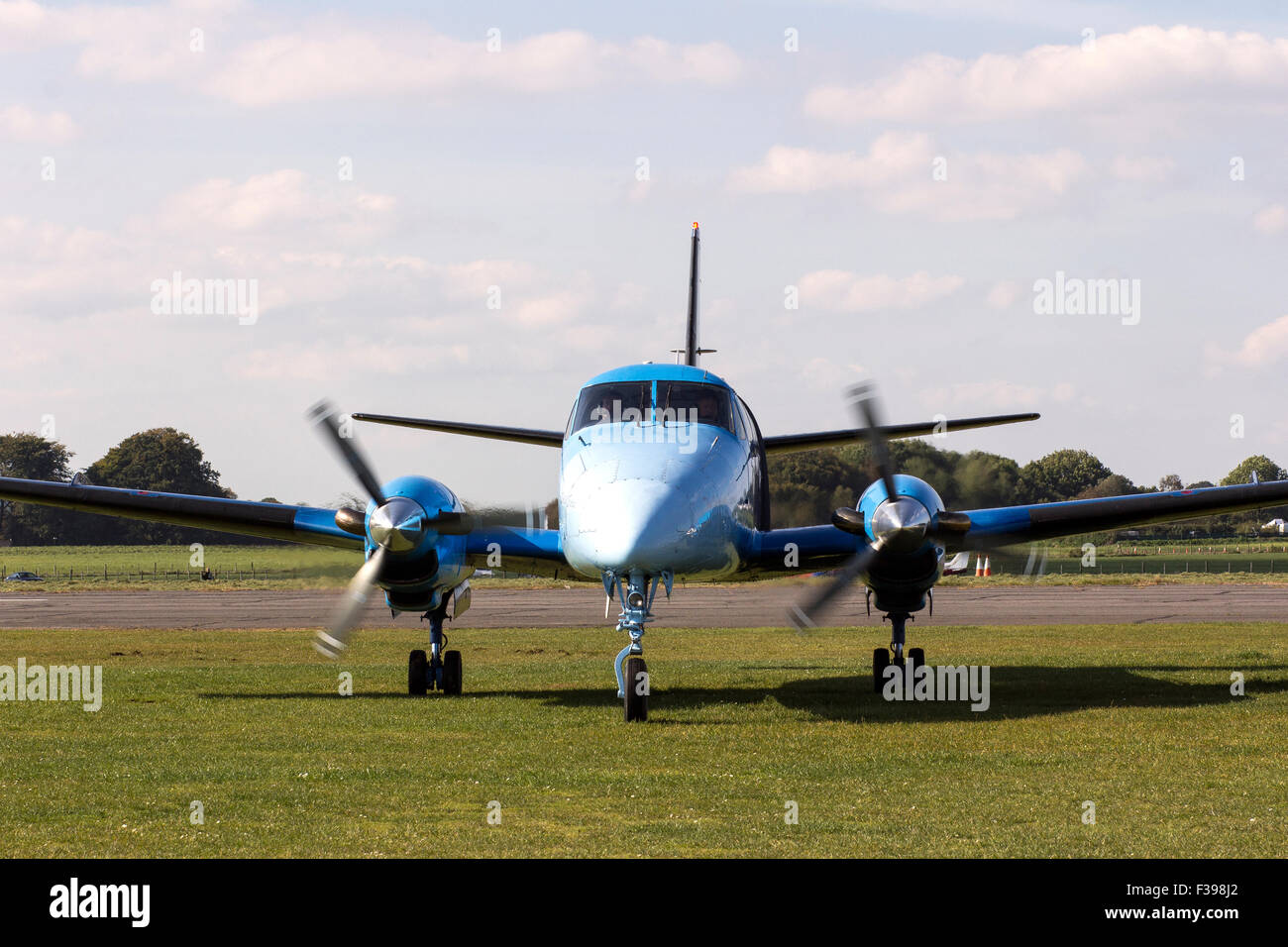 Taxiing, also sometimes written 'taxying', is the movement of an aircraft on the ground, under its own power, - Stock Image