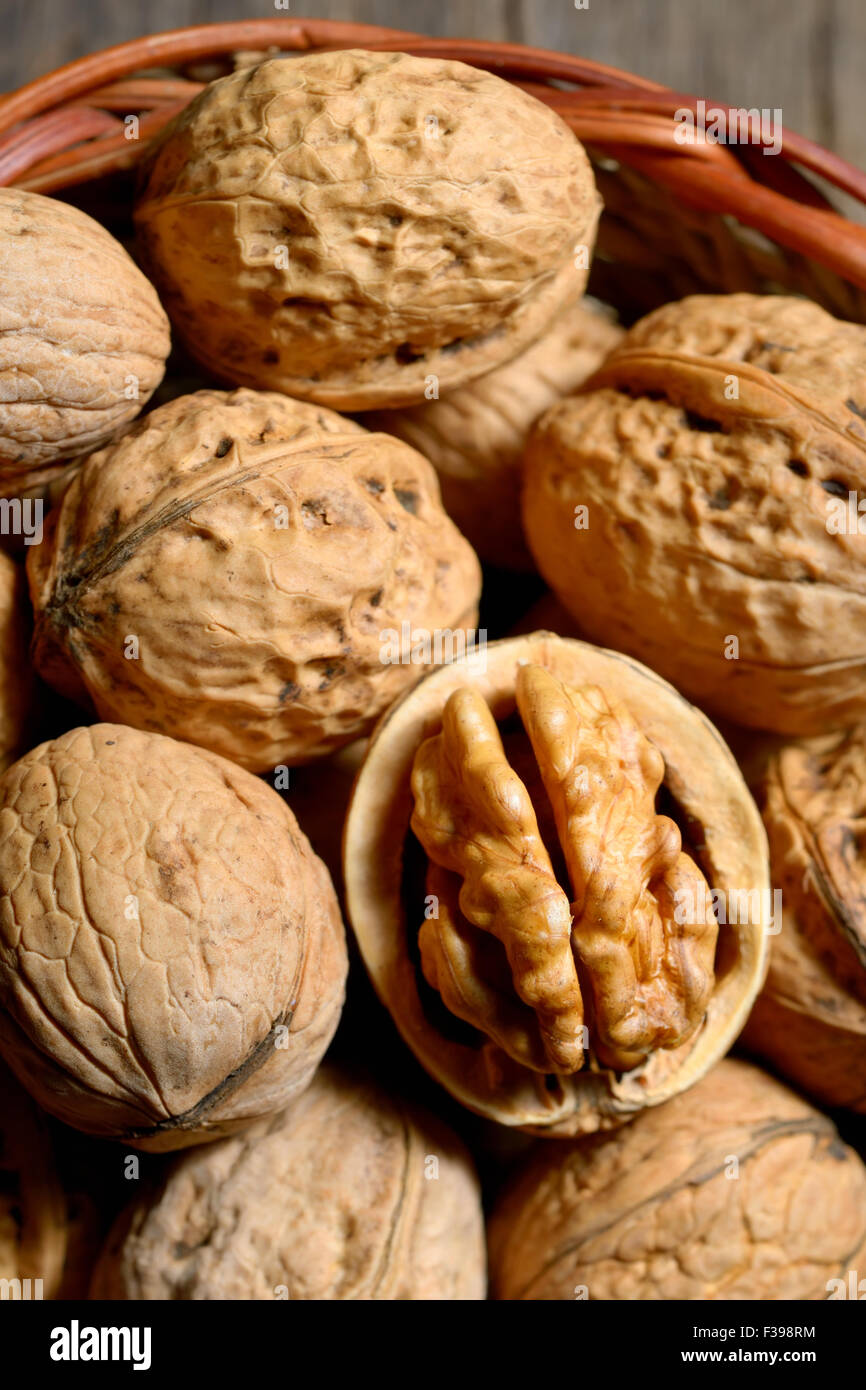 Macro dried  walnuts in basket Stock Photo