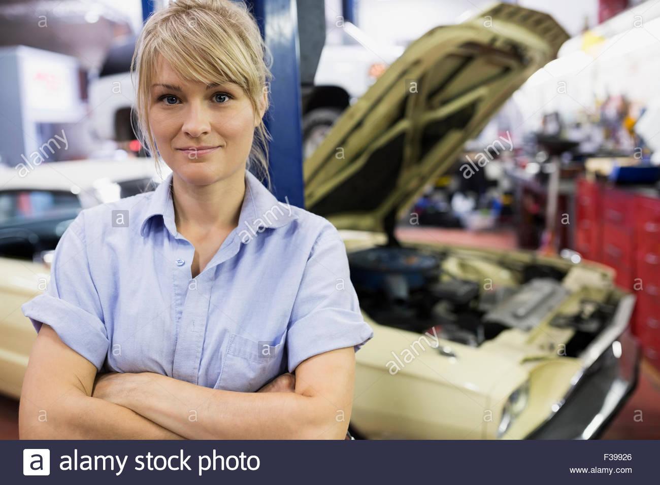 Portrait confident female mechanic in auto repairs hop - Stock Image