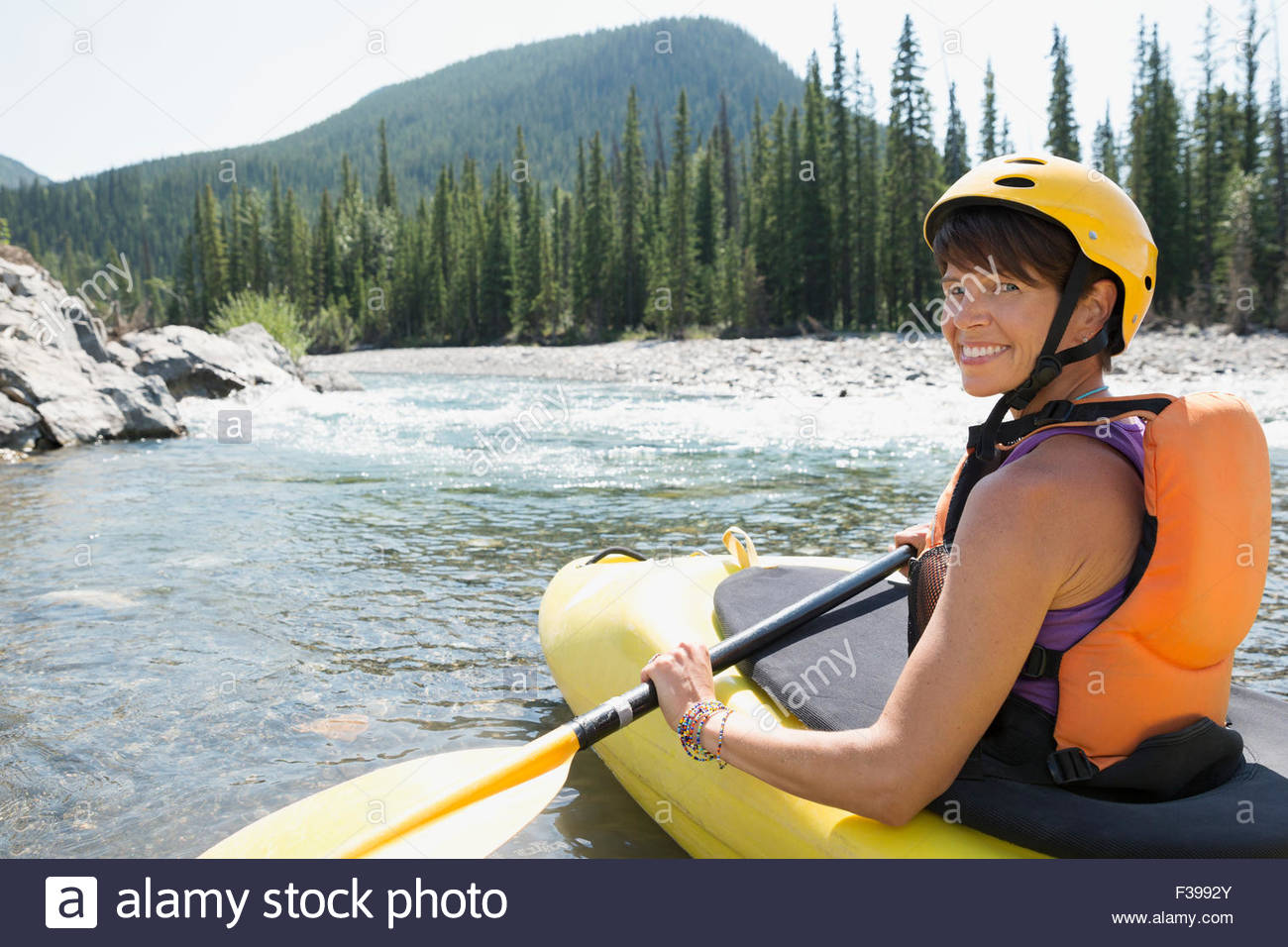 Portrait smiling woman kayaking in river Stock Photo