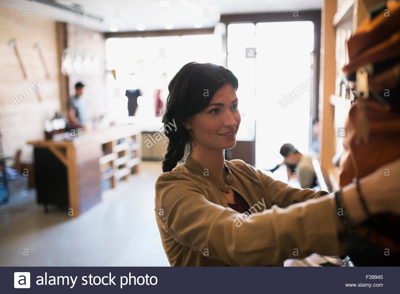Woman browsing in shop - Stock Image