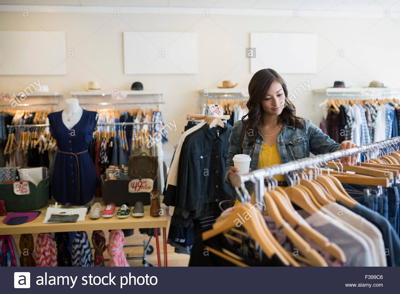 3bd6f82bdcdef Woman browsing clothing in shop Stock Photo: 88100774 - Alamy
